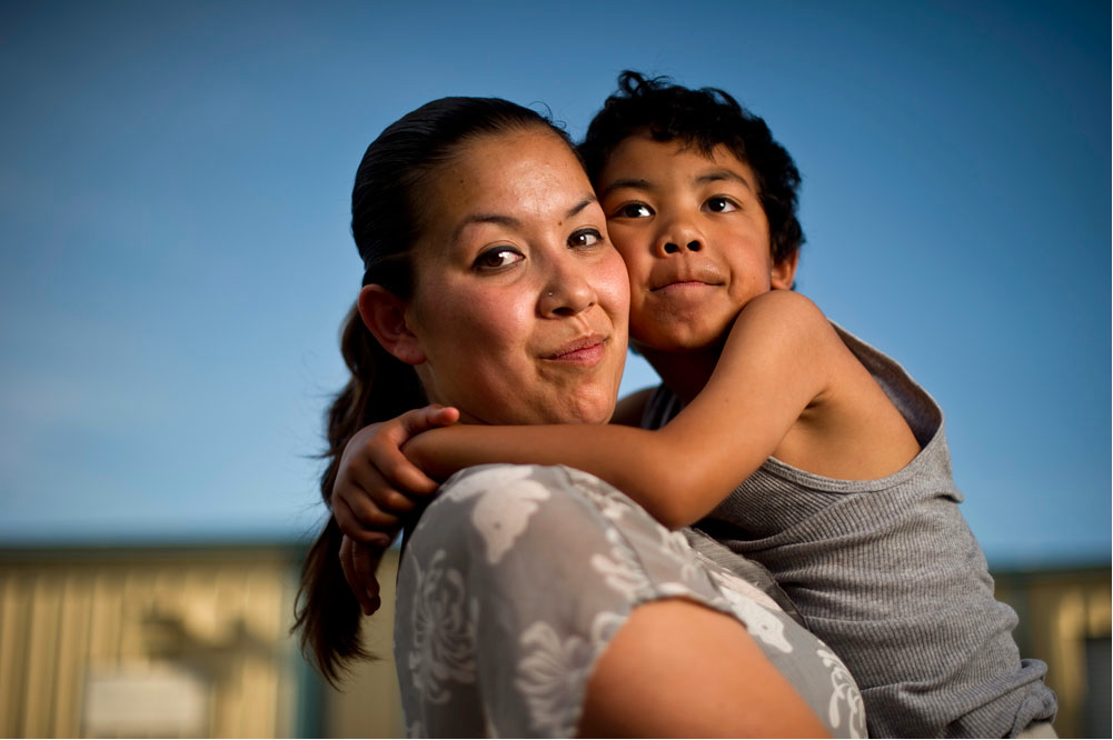 Crystal Nguyen, with her 6-year-old son, Neiko, in Pittsburg, Calif., is a former Valley State Prison for Women inmate. She worked in the prison's infirmary in 2007 and says she often overheard medical staff asking inmates who had served multiple prison terms to agree to be sterilized. Credit: Noah Berger/For The Center for Investigative Reporting