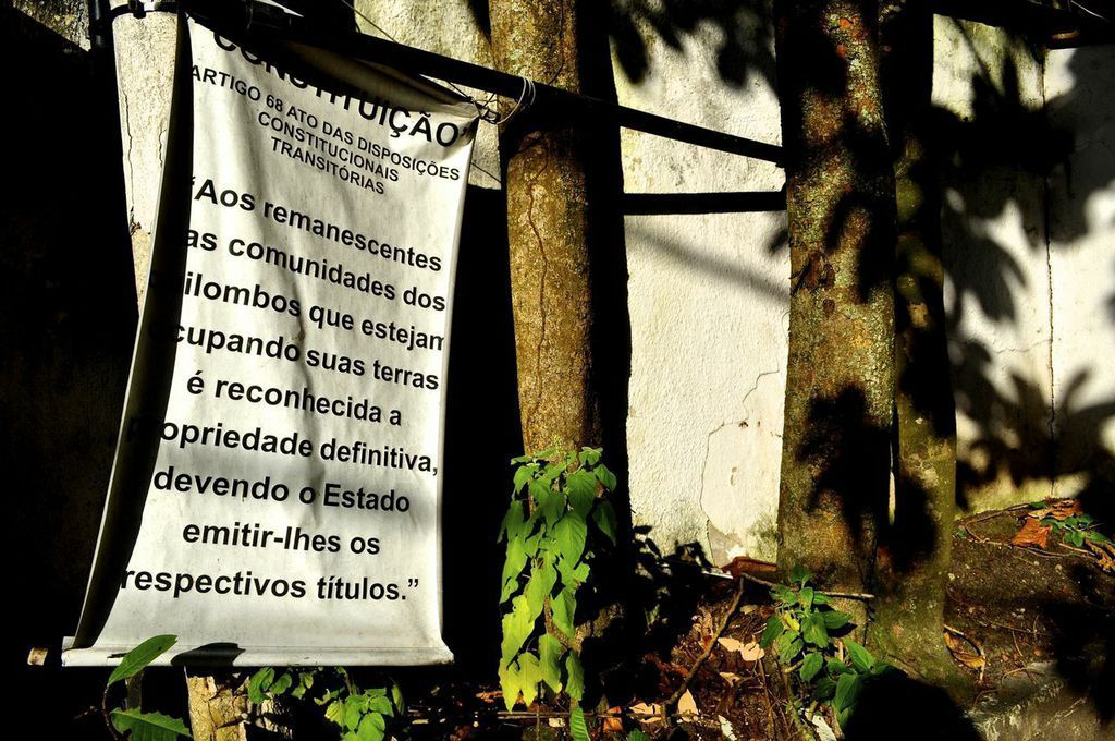 A sign in at the entrance to Sacopã announces the community's quilombo status. (Carolina Ramirez/The Huffington Post)