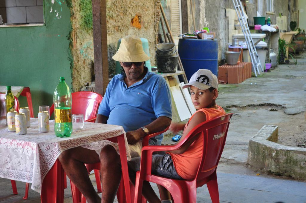 Luiz Pinto and his grandson in the area of their quilombo that once hosted lively parties. Neighbors' complaints have since shut down the events. (Carolina Ramirez/The Huffington Post)