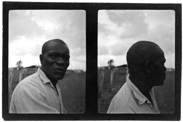 "James ""Iron Head"" Baker at a prison in Sugar Land, Texas in June, 1934. With fellow inmates, he made the first known recording of the iconic work song ""Ain't No More Cane on the Brazos."" / Alan Lomax, Library of Congress."
