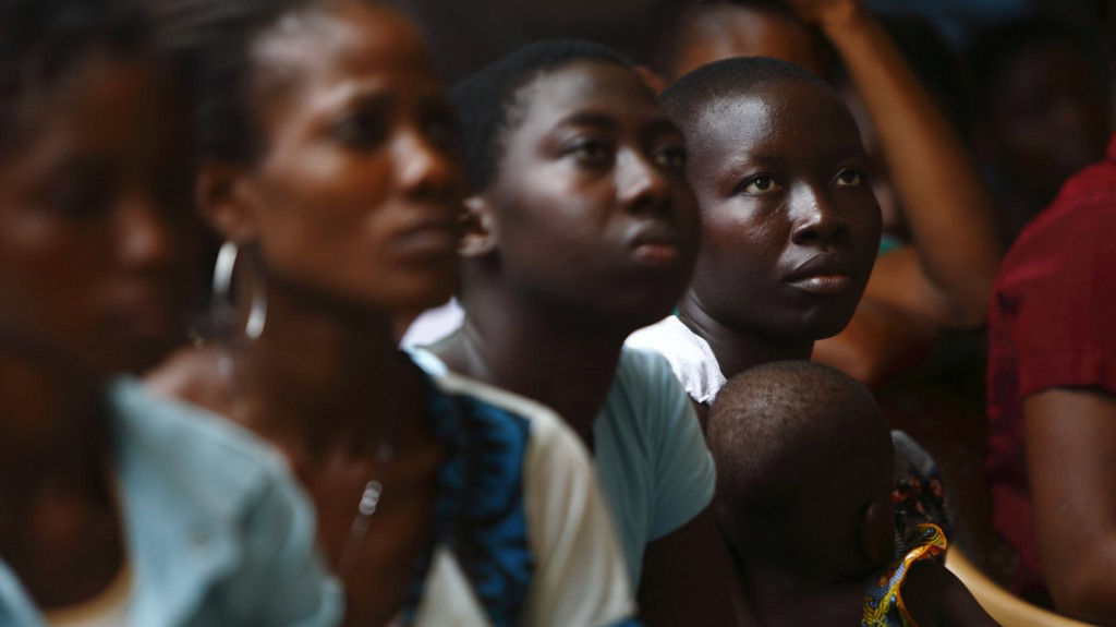 Young women listen to a talk on domestic violence and HIV prevention near Lome, Togo, in April. Abused women in sub-Saharan Africa and India are at higher risk for HIV than women who haven't experienced violence. / Darrin Zammit Lupi/Reuters/Landov