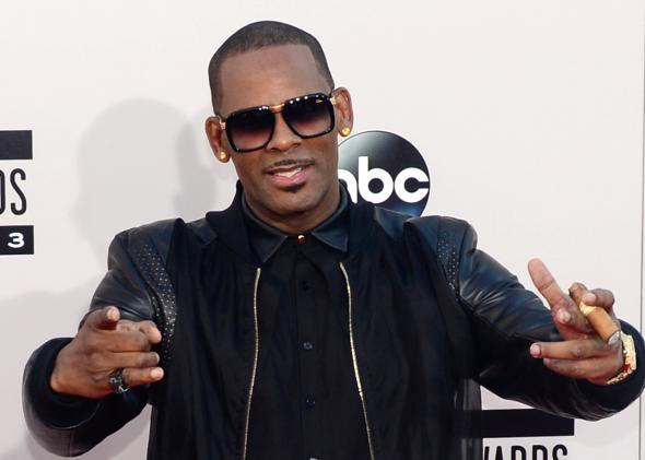 R. Kelly arrives at the 2013 American Music Awards in Los Angeles. / Photo by Frederic J. Brown/AFP/Getty Images