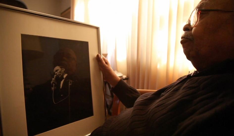 Chuck Stewart holds a framed photograph of Frank Sinatra in his home in Teaneck, New Jersey on Jan. 31, 2015.  JARED T. MILLER FOR NEWSWEEK