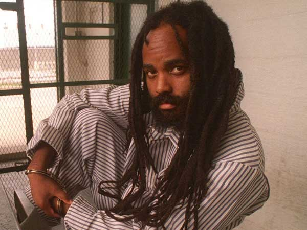 Mumia Abu-Jamal on death row in the 1990s. (APRIL SAUL / File Photograph) Read more at http://www.philly.com/philly/news/local/20150401_Mystery_surrounds_Mumia_Abu-Jamal_hospitalization.html#iQf3fjRcZ65qmhsO.99