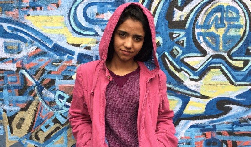 "Afghan rapper Sonita Alizadeh narrowly escaped a forced marriage at 14 by writing the song ""Brides for Sale."" She recently visited West Oakland, California, and was surprised that the US, like Iran and Afghanistan, has poor neighborhoods and homeless people. Credit: Shuka Kalantari. Published with PRI's permission."