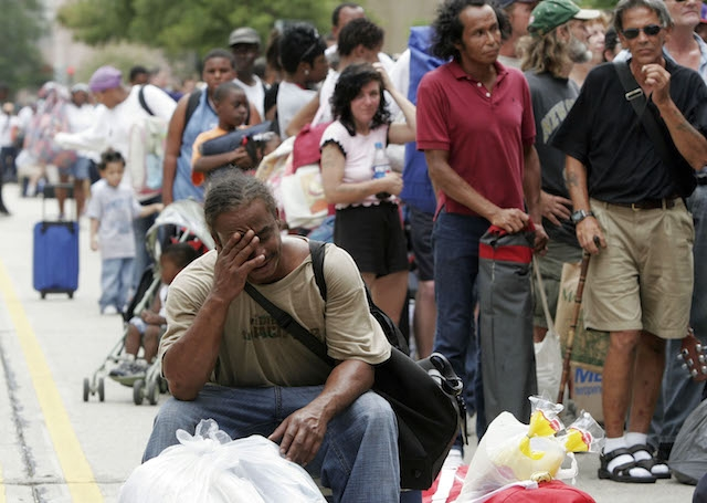 On August 28, 2005, Roy Marigny wipes his forehead in the heat while waiting for the New Orleans Superdome to open as an emergency shelter ahead of Hurricane Katrina. Photo: Chris Graythen/Getty Images