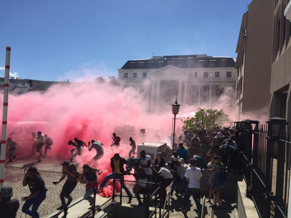 Police firing teargas at protesting students on Parliament grounds. Image Credit: @LionelAdendorf on Twitter