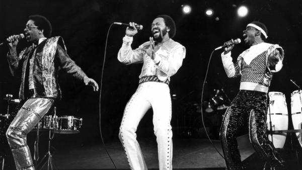 Maurice White, center, leads Earth Wind & Fire at the Forum in Inglewood on Dec. 12, 1981. (Tony Barnard / Los Angeles Times)