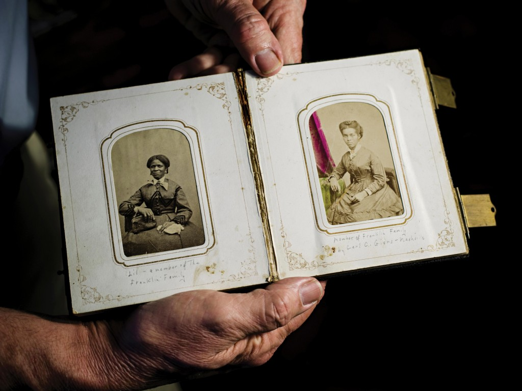 An album identifies two members of another branch of Thomson's family. (Wayne Lawrence)