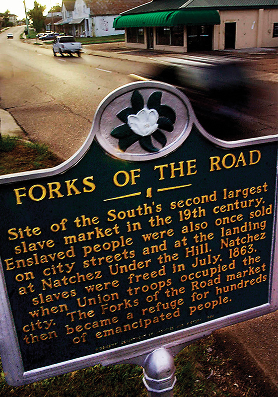 A sign marks the site of the market just outside Natchez where slaves were bargained over rather than auctioned. (AP Photo/The Natchez Democrat, Ben Hillyer)