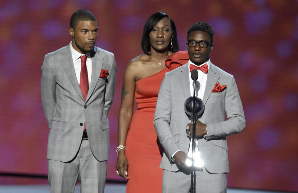 Markastin Taylor, from left, Zenobia Dobson and Zackelyn Dobson accept the Arthur Ashe award for courage on behalf of Zaevion Dobson at the ESPY Awards at the Microsoft Theater on Wednesday, July 13, 2016, in Los Angeles. (Photo by Chris Pizzello/Invision/AP) Associated Press