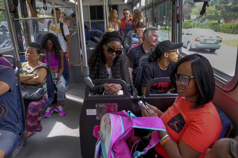 Diamond Reynolds, center, her sister, Ariel Doty, foreground, and other family members and friends ride a shuttle bus to the Minnesota State Fair on Aug. 26. (Jahi Chikwendiu/The Washington Post)