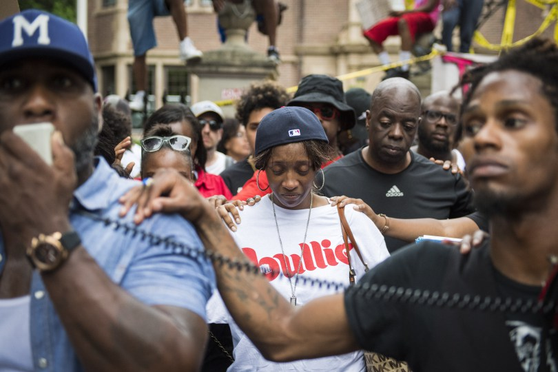 Diamond Reynolds, center, is comforted during a demonstration outside the Minnesota governor's mansion on July 7, the day after the police-involved fatal shooting of her boyfriend, Philando Castile. (Jabin Botsford/The Washington Post)