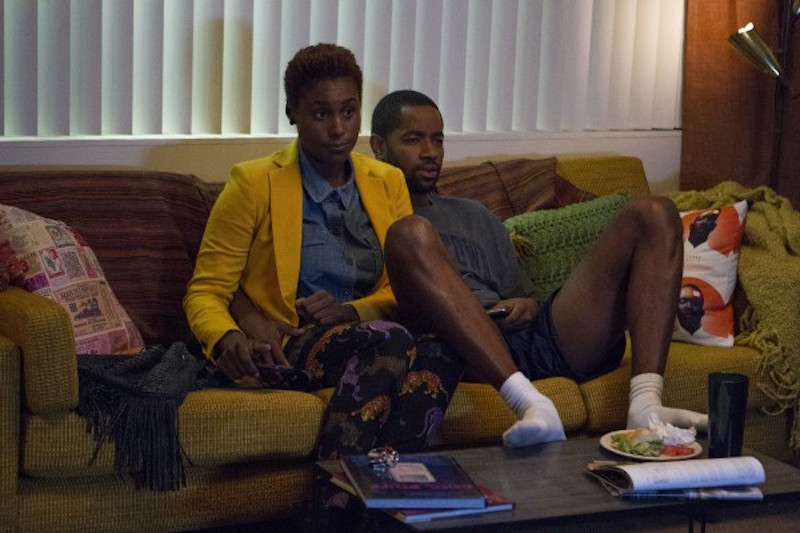 Issa and Lawrence (Jay Ellis) just doing what couples do.