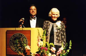 """Martha Heasley Cox receiving San José State University's """"Tower Award"""" from President Robert Caret in 2006 for her generosity in supporting many causes, including the Steinbeck Fellows Program."""