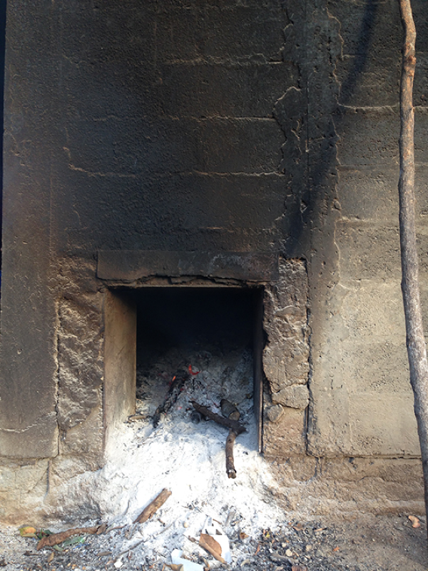 a traditional wood fire heats the toasting vats – photo by Paulette Richards