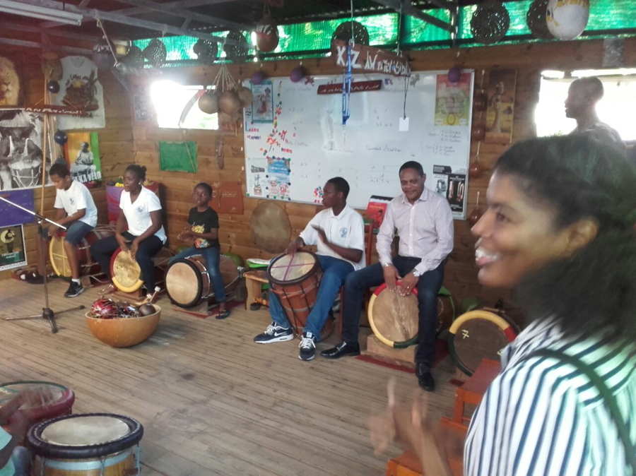 Mayor Baptiste plays the drum on the far right