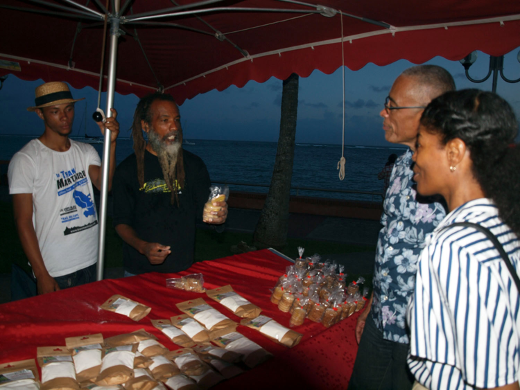 Widy Grego touts his manioc flour cookies with apprentice Zidane at his side – photo by Patrice Ganot