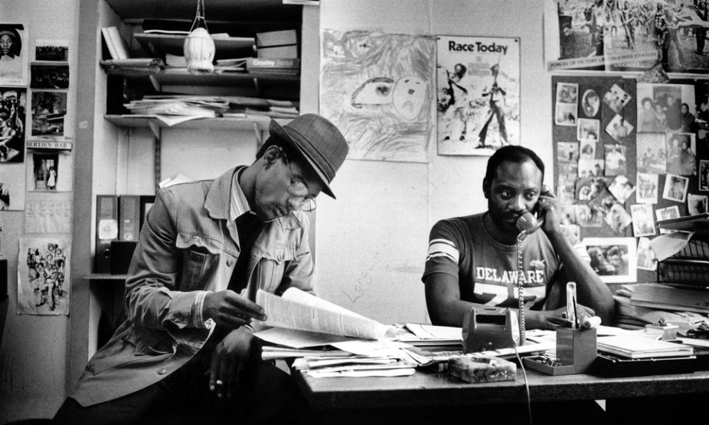 Poet Linton Kwesi Johnson and Darcus Howe at the Race Today office on Railton Road, Brixton, 1979 Photograph: Adrian Boot/Adrian Boot / urbanimage.tv