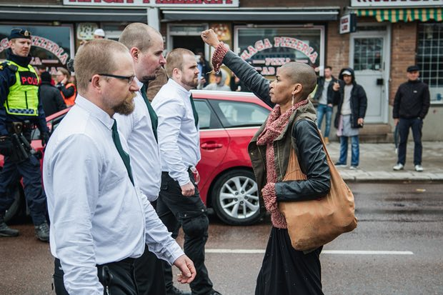 A lone woman stands up to uniformed demonstrators in a Nazi demonstration in Borlänge, Sweden on 1 May 2015. Photograph: David Lagerlöf/TT News Agency/PA