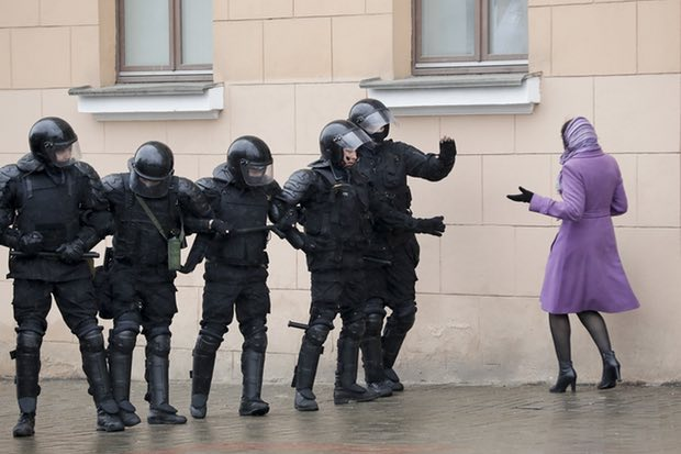 A woman argues with Belarus police officers blocking a street during an opposition rally in Minsk, Belarus, on 25 March 2017. Photograph: Sergei Grits/AP