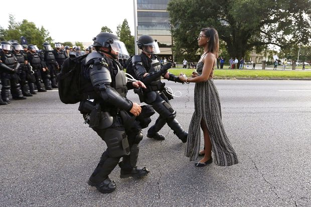 Ieshia Evans and riot police during a protest against police brutality at the Baton Rouge police department in Louisiana on 9 July 2016. Photograph: Jonathan Bachman/Reuters