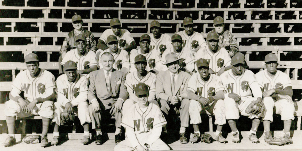 Team photo of the 1950 ManDak League champions, the Winnipeg Buffaloes. Manager Willie Wells is seated to the right of owner Stanley Zeed (first row, third from the left). Leon Day is seated on the far left of the middle row. (Jay-Dell Mah Collection, courtesy of Tazena Kennedy)