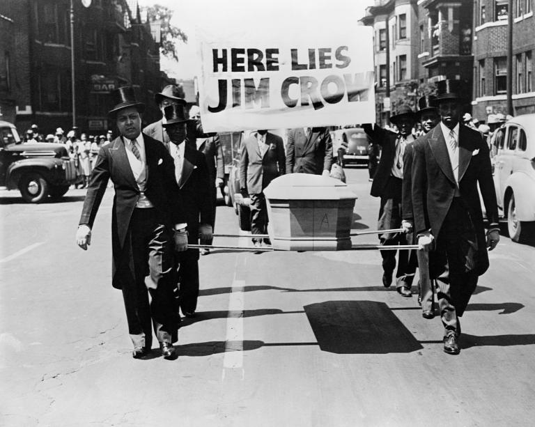 Men carry the coffin of Jim Crow through the streets to protest racial discrimination in 1944. / PHOTOGRAPH BY CORBIS