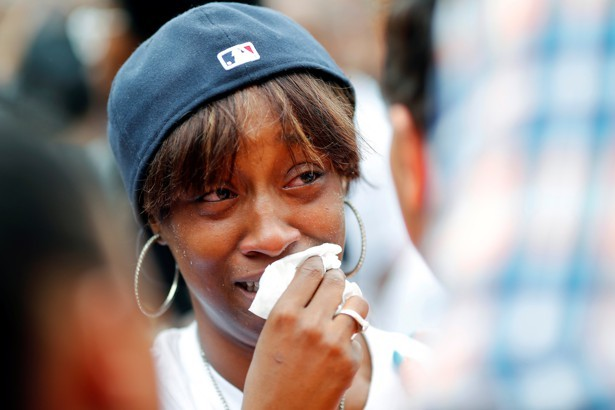 Diamond Reynolds, girlfriend of Philando Castile, weeps at a protest in St. Paul, Minnesota, on July 7, 2016.  Adam Bettcher / Reuters