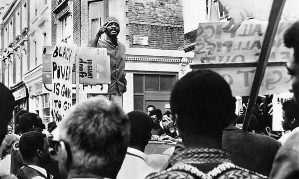 Darkus Howe addresses a rally for the Mangrove Nine in Notting Hill in 1971. / Photograph: Horace Ove